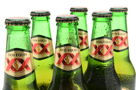 6 pack beer: IRVINE, CA - MAY 25, 2014: Closeup of Dos Equis Lager Bottles. Founded in 1890 from the Cuauhtemoc-Moctezuma Brewery in Monterrey, Mexico a subsidary of Heineken International. Editorial