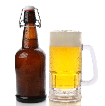 old items: Closeup of a Mug of beer with a frothy head next to a swing top brown beer bottle. Straight on shot on a white background with reflection. Both items are cover with water drops.