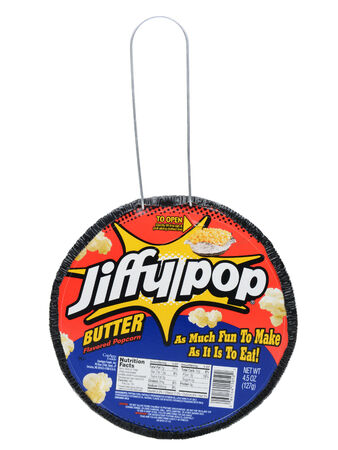 IRVINE, CA - DECEMBER 12, 2013: A package of Jiffy Pop Popcorn. Jiffy Pop combines popcorn kernels, oil, and flavoring with a heavy-gauge expandable aluminum foil pan and a light-gauge aluminum foil cover. Editorial