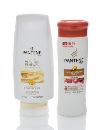IRVINE, CA - DECEMBER 12, 2014: Two bottles of Pantene Hair Care Products. Introduced in Europe in 1947 by Hoffmann-La Roche of Switzerland, the name based on panthenol as a shampoo ingredient. Редакционное