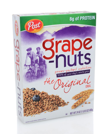 cereal box: IRVINE, CA - DECEMBER 12, 2013: A 24 ounce box of Post Grape-Nuts. Developed in 1897 by C. W. Post, the cereal is made with wheat and barley and does not contain grapes or nuts.