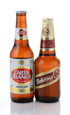 international beer: IRVINE, CA - JANUARY, 11, 2015: A botlle of Carta Blanca and Bohemia beer. From Cerveceria Cuauhtemoc-Moctezuma, founded in 1890, now a subsidiary of Heineken International.