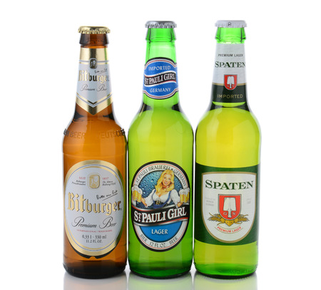 st german: IRVINE, CA - JANUARY, 11, 2015: Three bottles of German beers. St, Pauli Girl, Spaten and Bitburger are three popular German beers imported into the United States.