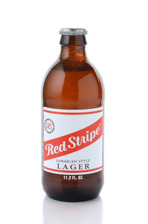 IRVINE, CA - JANUARY, 11, 2015: A single bottle of Red Stripe Jamaican Style Lager. Brewed in Jamaica since 1938 by Desnoes & Geddes its international distribution is handled by Diageo.