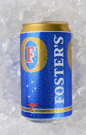 domestically: IRVINE, CA - JANUARY 12, 2015: A single 750ml can of Fosters Lager on a bed of ice. The brand has more international recognition outside of Australia than it does domestically.