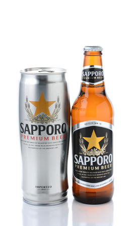IRVINE, CA - JANUARY 12, 2015: A can and bottle of Sapporo Beer isolated on white. The Japanese brewery was founded in 1876 by German trained brewer Seibei Nakagawa. It is the oldest beer brand in Japan. Editorial