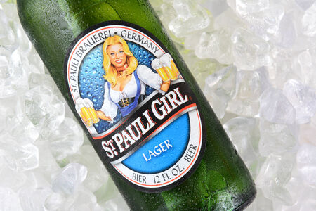 st pauli: IRVINE, CA - JANUARY 12, 2015: A bottle of St. Pauli Girl Beer on a bed of ice. The brand gets its name for it original location, next to St. Pauls Monastery in Bremen. Its now Brewed at the Becks facility. Editorial