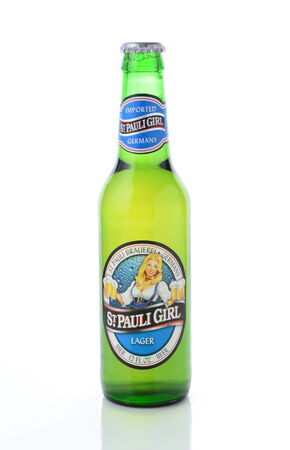 st pauli: IRVINE, CA - JANUARY 12, 2015: A bottle of St. Pauli Girl Beer isolated on white. The brand gets its name for it original location, next to St. Pauls Monastery in Bremen. Its now Brewed at the Becks facility.