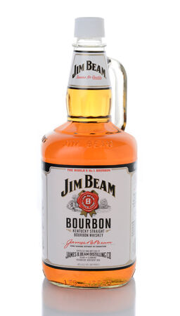 liter: IRVINE, CA - JANUARY 15, 2015: A 1.75 liter bottle of Jim Beam Kentucky Bourbon. Since 1795 seven generations of the Beam family have been involved in whiskey making for the company.