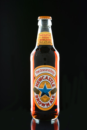 brewers: IRVINE, CA - JANUARY 15, 2015: A bottle of Newcastle Brown Ale. Launched in 1927 by Colonel Jim Porter after the merger of Newcastle Breweries with Scottish Brewers. Editorial