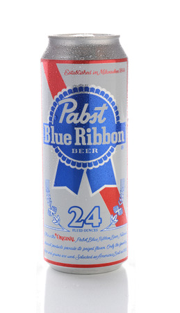beer can: IRVINE, CA - JANUARY 15, 2015: A 24 ounce can of Pabst Blue Ribbon Beer. Established in Milwaukee in 1844, the name comes from the blue ribbons tied around the bottle neck from 1882-1916.