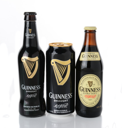 draught: IRVINE, CA - JANUARY 12, 2015: Three beers from the Guinness Brewing Company, Stout bottle and Draught can and bottle.  Guinness has been producing beer in Ireland since 1759.