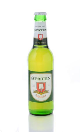 IRVINE, CA - JANUARY 11, 2015: A bottle of Spaten Lager isolated on white with reflection. The Spaten-Franziskaner-Brau GmbH is a brewery in Munich, Germany.