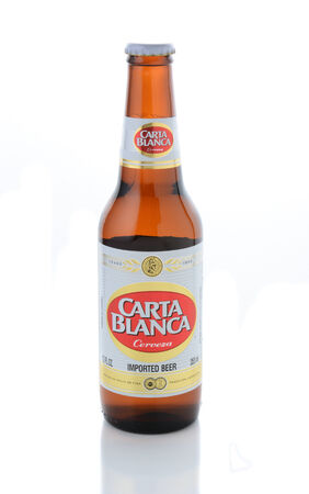 international beer: IRVINE, CA - JANUARY 11, 2015: A bottle of Carta Blanca Beer on white. From Cerveceria Cuauhtemoc-Moctezuma, founded in 1890, now a subsidiary of Heineken International.