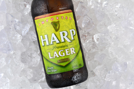 IRVINE, CA - JANUARY 11, 2015: Closeup of a single bottle of Harp Lager on a bed of ice. Harp is an Irish lager created in 1960 by the Guinness Brewing Co., brewed with pure water from the Cooley Mountains.
