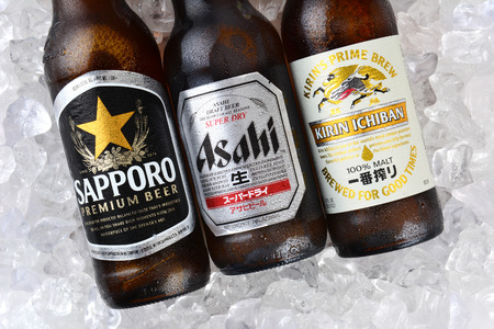 brewery: IRVINE, CA - JANUARY 11, 2015: Three bottles of Japanese beers on a bed of ice. Sapporo, Asahi and Kirin Ichiban are three of the most popular Japanese beers imported into the USA