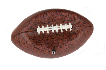 Closeup of an NFL American style football partially deflated with teh valve stem still inserted. Isolated on white. Stock Photo