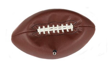 Primo piano di uno stile football NFL americano parzialmente deflazionato con teh stelo della valvola ancora inserito. Isolati su bianco. Archivio Fotografico - 35797874