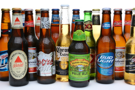 IRVINE, CA - JULY14, 2014: An assortment of domestic and imported beers on white. Brands include, Coors, Budweiser, Corona, Bass, MGD, Miller Lite, Sierra Nevada, Samuel Adams, Dos Equis.