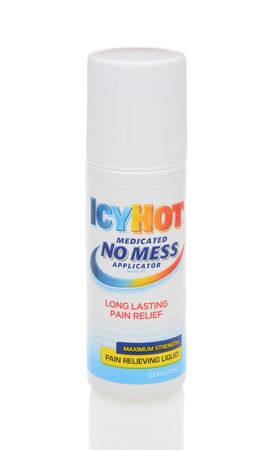 strains: IRVINE, CA - DECEMBER 12, 2014: A No Mess Applicator of IcyHot. IcyHot is a topical heat rub meant for relieving pains such as arthritis, backache, muscle strains, sprains, and cramps