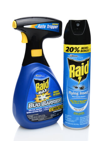 raid: IRVINE, CA - SEPTEMBER 15, 2014: A bottle of Raid Max Bug Barrier and Flying Insect. Raid is the brand name of a line of insecticide products produced by S. C. Johnson & Son, first launched in 1956. Editorial