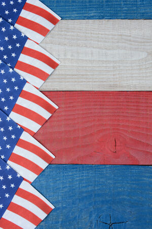 high angle shot: High angle shot of American Flag napkins spread out on a red, white and blue picnic table. Vertical format with copy space. Suitable for American Holidays: 4th of July and Memorial Day,