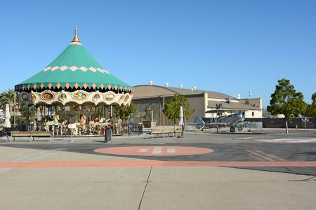orange county: IRVINE, CA - FEBRUARY 10, 2015: The Orange County Great Park Carousel Ride, with vintage airplane and hangar. The park is being built on the former Marine Corps Air Station, El Toro.