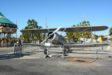 an era: IRVINE, CA - FEBRUARY 10, 2015: Vintage airplanes at the Orange County Great Park. An N3N-3 Canary and SNJ-5 Texan WWII era planes on display at the Great Park in Irvine, California. Editorial
