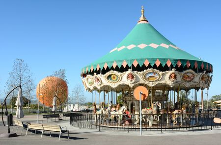 orange county: IRVINE, CA - FEBRUARY 10, 2015: The Orange County Great Park Carousel Ride. The carousel ride is one of two current attractions at the Great Park, the other being the balloon, in the background.