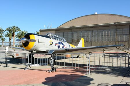 texan: IRVINE, CA - FEBRUARY 10, 2015: Plane and Hangar at the Orange County Great Park. An SNJ-5 Texan WWII era plane on display at the Great Park in Irvine, California.