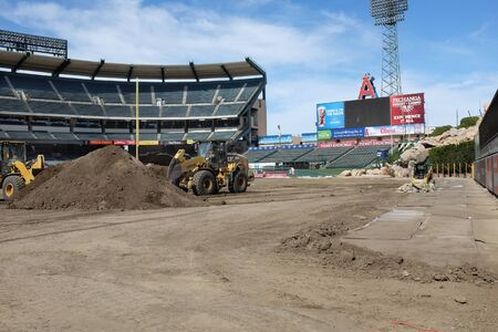 monster truck: ANAHEIM, CA - FEBRUARY 11, 2015: Angel Stadium of Anaheim field cleanup. Workers remove dirt from inside Angel Stadium after the Motocross and Monster Truck Series. Editorial
