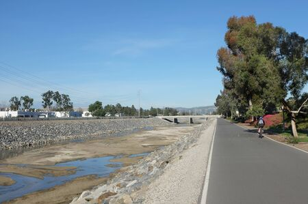 bike trail: IRVINE, CA - FEBRUARY 12, 2015: The San Diego Creek Bike Trail part of the Mountains to Sea Trail. The 22 mile trail runs from Weir Canyon in Irvine, to Upper Newport Bay, Newport Beach. Editorial