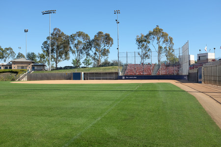 backstop: IRVINE, CA - FEBRUARY 12, 2015: Deanna Manning Stadium seen from the left field line. The stadium hosts local slow pitch and fast pitch softball teams as well as international tournaments. Editorial