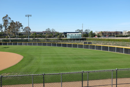 sports venue: IRVINE, CA - FEBRUARY 12, 2015: Deanna Manning Stadium scoreboard and right field. The stadium hosts local slow pitch and fast pitch softball teams and international tournaments.