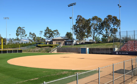 outfield: IRVINE, CA - FEBRUARY 12, 2015: Deanna Manning Stadium Softball Field infield. The stadium hosts local slow pitch and fast pitch softball teams as well as international tournaments.