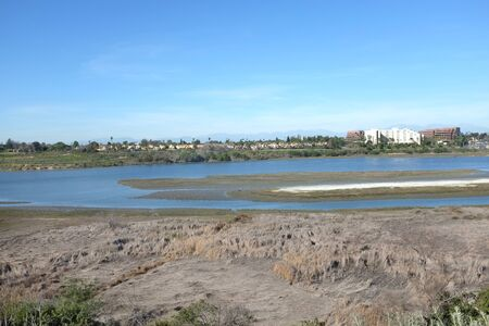 watershed: NEWPORT BEACH, CA - FEBRUARY 12, 2015: Upper Newport Bay with homes and business in the background. Upper Newport Bay Nature Preserve and Ecological Reserve covers almost 1,000 acres of open space.