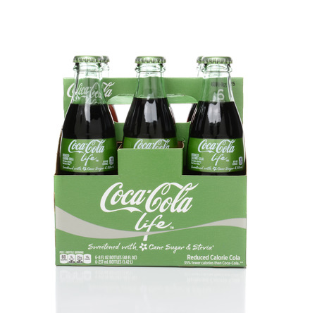 6 pack: IRVINE, CA - FEBRUARY 15, 2015: 6 pack bottles of Coca-Cola Life side view. A reduced calorie soft drink sweetened with cane sugar and Stevia, containing 60% of the calories of Classic Coke.
