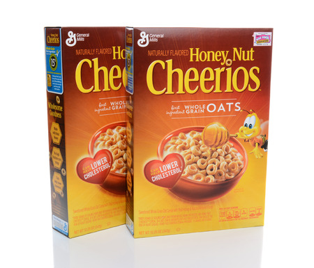 cereal box: IRVINE, CA - FEBRUARY 19, 2015: Two boxes of Honey Nut Cheerios. Introduced in 1979 by General Mills it is a slightly sweeter version of the original Cheerios breakfast cereal. Editorial