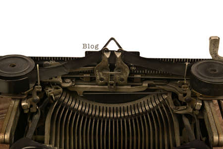 An old fashioned typewriter with the word Blog. Closeup of the antique machines ribbon and carriage. With warm vintage tones. photo