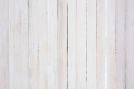 slats: Closeup of a rustic whitewashed wood background. The boards are straight up and dow.