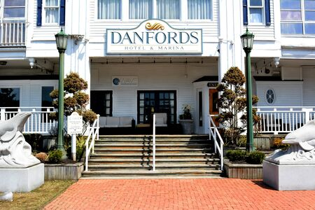 upscale: PORT JEFFERSON, NY - April 6, 2015: Danfords Hotel and Marina main entrance. On Long Island Sound estuary this upscale property features a spa, seafood restaurant and marina.