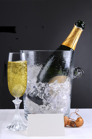 ice bucket: Closeup of a crystal champagne ice bucket and a full glass of bubbly.  Stock Photo