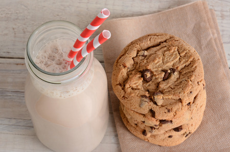 Chocolate Milk and Cookies shot from a high angle. Horizontal format on a wood kitchen table. After school treat.