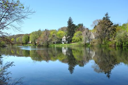 north shore: SETAUKET, NY - MAY 4, 2015: Houses along the upper pond in Setauket, New York. Setauket is on the North Shore of Long Island.