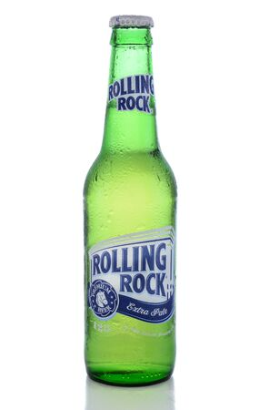 IRVINE, CA - JUNE 14, 2015: Rolling Rock Extra Pale Beer. A single bottle of the American beer founded in 1939 in Latrobe, Pennsylvania, by the Latrobe Brewing Co.