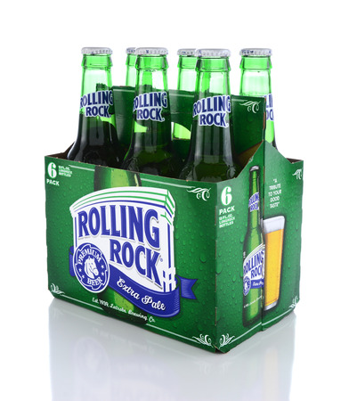 IRVINE, CA - JUNE 14, 2015: Rolling Rock Extra Pale Beer. Three quarters view of a six pack of the American beer founded in 1939 in Latrobe, Pennsylvania, by the Latrobe Brewing Co. Editorial