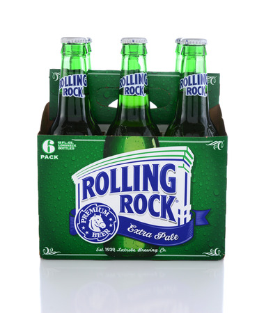 6 pack beer: IRVINE, CA - JUNE 14, 2015: Rolling Rock Extra Pale Beer. Side view of a six pack of the American beer founded in 1939 in Latrobe, Pennsylvania, by the Latrobe Brewing Co. Editorial