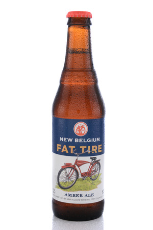 tire: IRVINE, CA - JUNE 14, 2015: Fat Tire Amber Ale. A single bottle of Fat Tire Amber Ale from the New Belgium Brewing Company, of Fort Collins, Colorado.