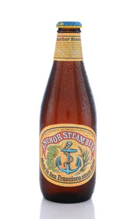 IRVINE, CA - JUNE 14, 2015: A single bottle of Anchor Steam Beer. Anchor Brewing Co. is one of the last remaining breweries to produce California common beer, also known as Steam Beer.