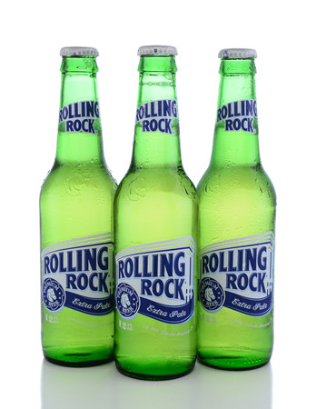 IRVINE, CA - JUNE 14, 2015: Rolling Rock Extra Pale Beer. Three bottles of the American beer founded in 1939 in Latrobe, Pennsylvania, by the Latrobe Brewing Co.
